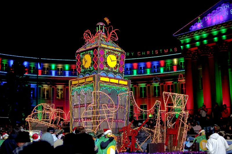 Colorful Christmas lit up floats at a parade