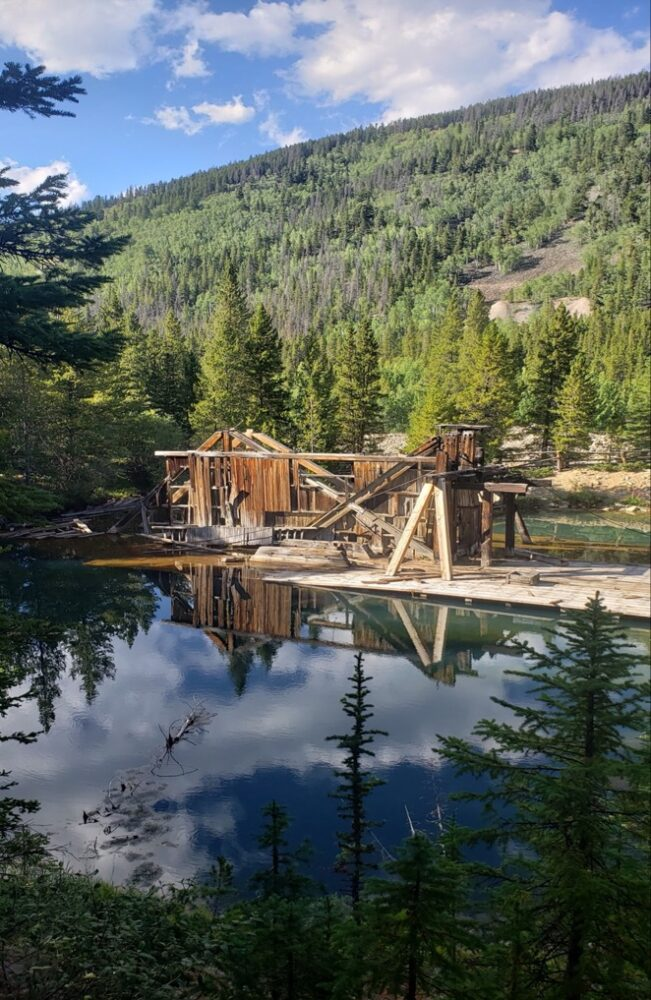 The remains of an old mine by the water in Breckenridge Colorado