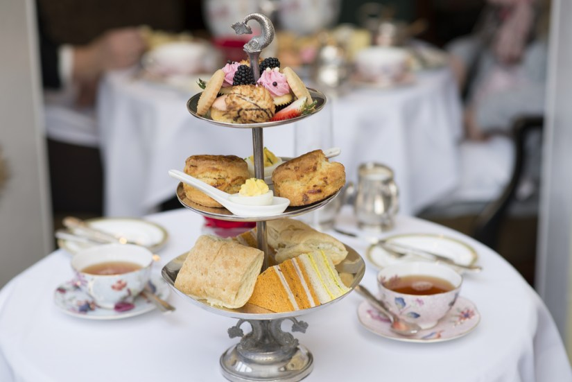 afternoon tea with a tiered tea cake stand and tea cups