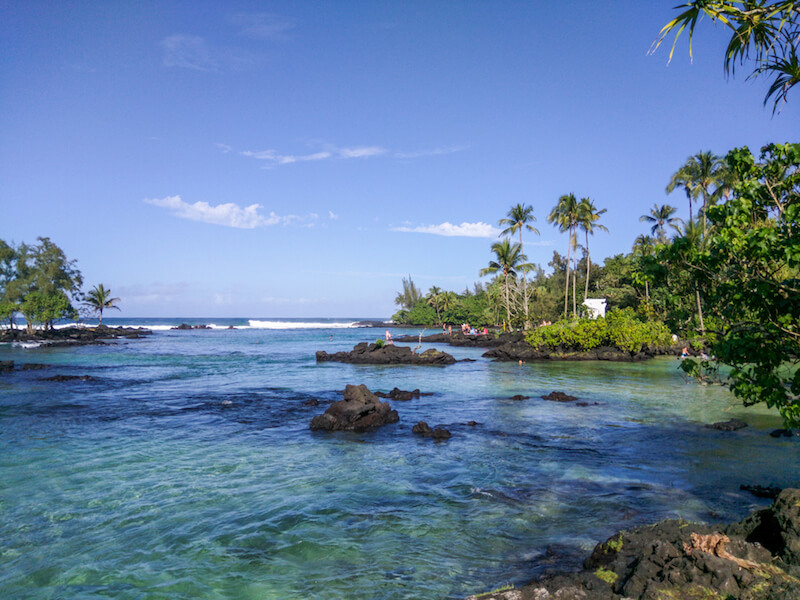 the turquoise waters of Carlsmith beach park is one of best places to swim and snorkel close to Hilo.