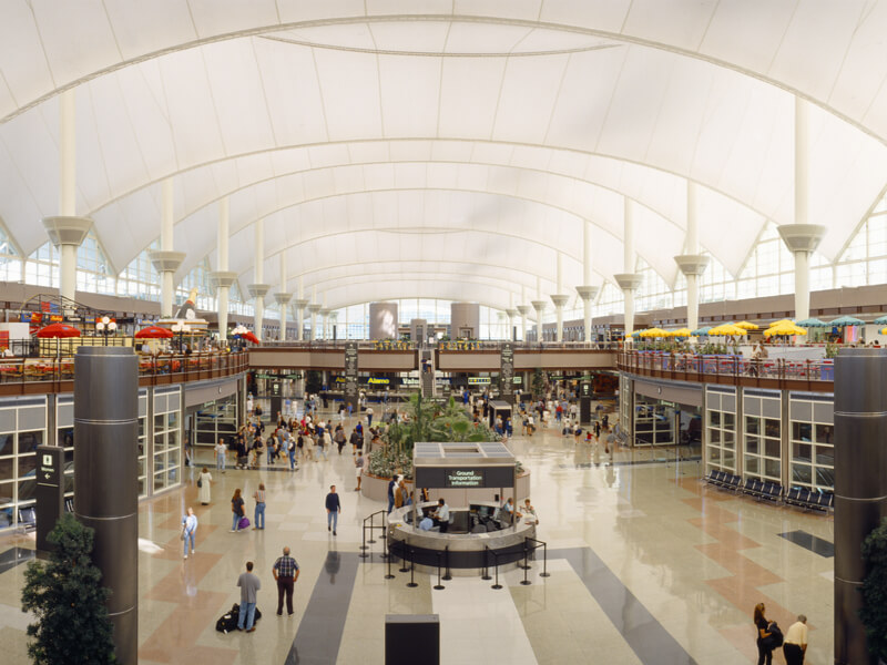 Denver International Airport - view of food courts and people walking around the airport interior