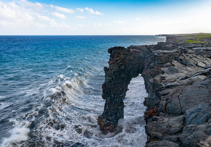 Sea arch made from cooled lava from a lava flow in Hawaii Volcanoes National Park