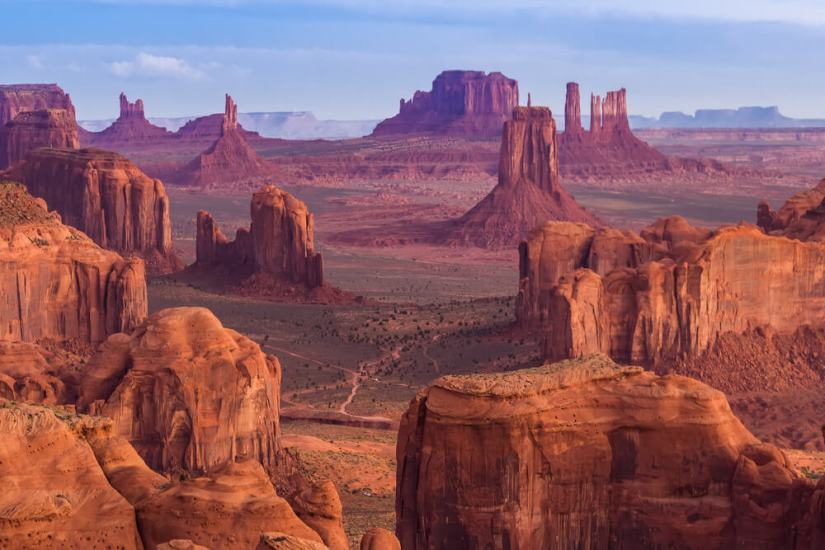 purple and reddish mesas at hunts mesa in monument valley