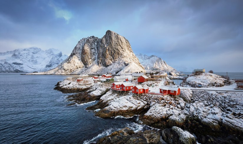 red fishing buildings on rocky islands in norway