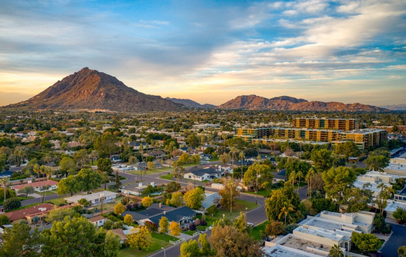 The city of Scottsdale Arizona at sunset with a small mountain peak in the distance