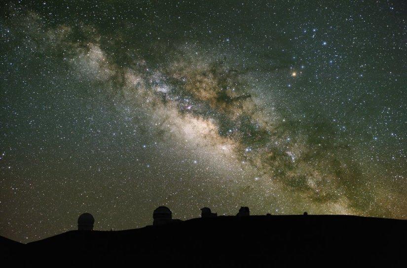 the stars of the milky way galaxy visible over the telescopes on mauna kea