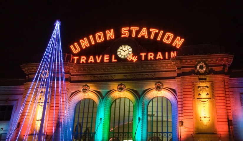 front of union station in Denver at christmas, colorful rainbow lights and christmas tree