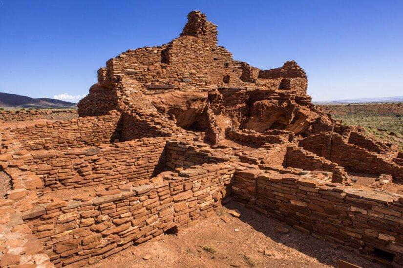 Historic Wupatki Ruin at Wupatki National Monument in Arizona, made of red rocks that look like bricks