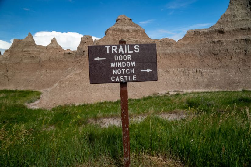 """Sign that reads trails """"Door, Window, Notch, Castle"""": 4 trailheads diverging from one point"""