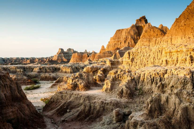 Sunrise falling on a rock formation near the Door Trail in Badlands National Park