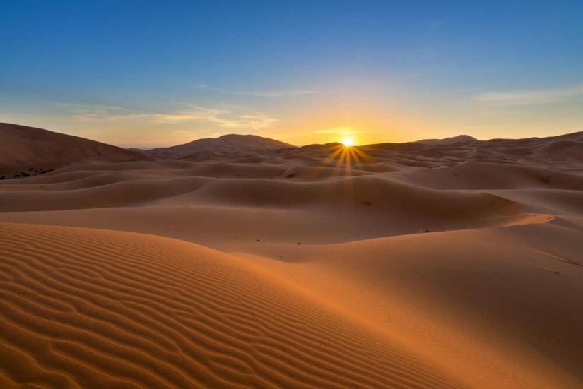 view of Erg Chebbi Dunes in the Sahara Desert - at sunrise, in Morocco