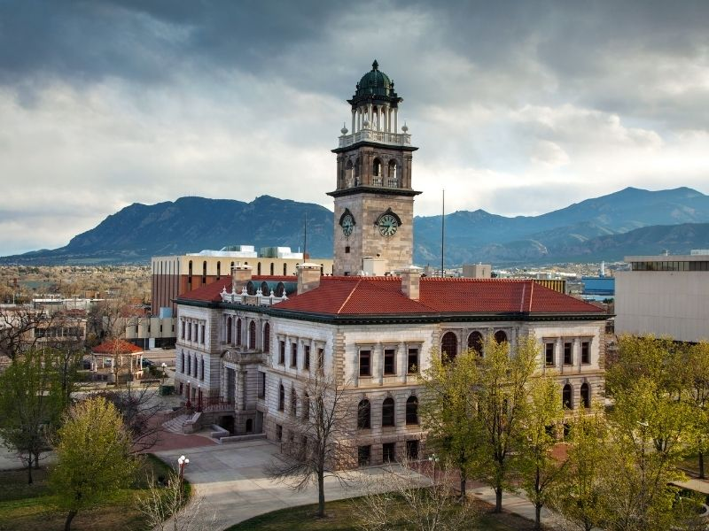 The downtown area of Colorado Springs CO with a giant clocktower and stone building facade