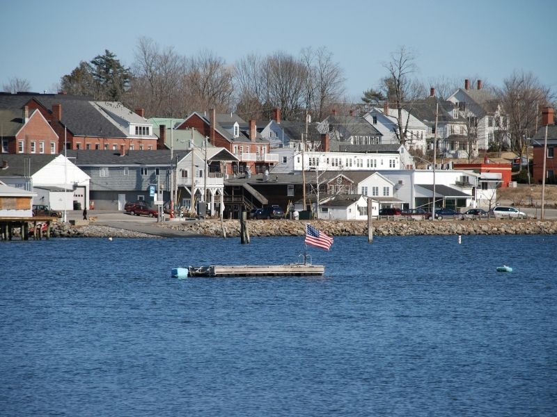 Harbor of Damariscotta as seen from the water with an American flag