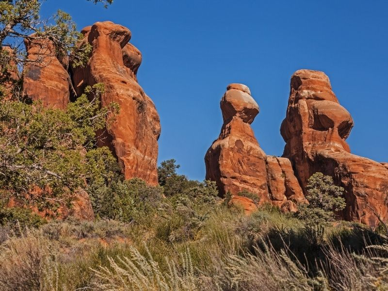 Strange, towering red rock formations of the Devils Garden section of Arches National Park on a sunny day