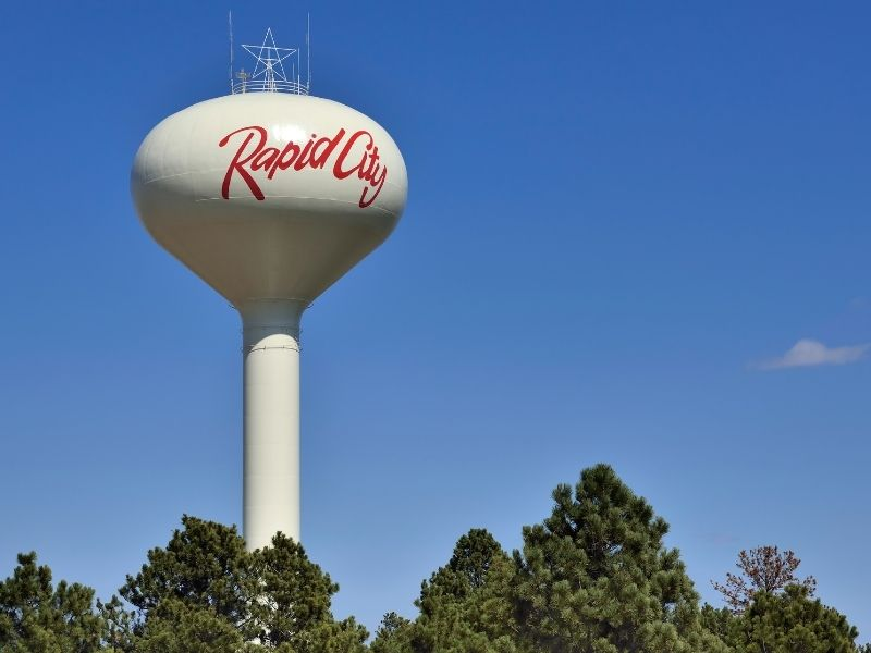Arriving in Rapid City, with a roadside attraction with the word 'rapid city' on it