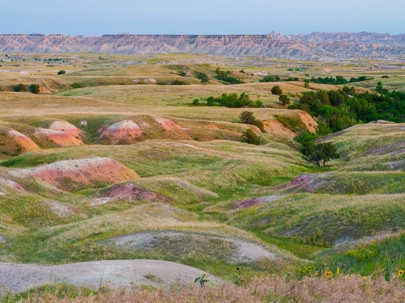 Driving through the Badlands along Sage Creek Road, seeing hills of beautiful colors