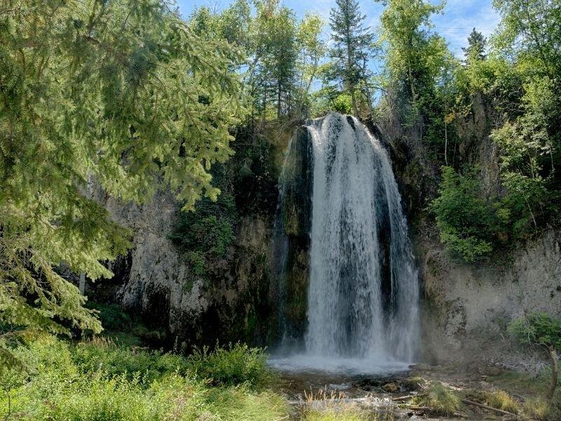 Waterfall in green oasis in Spearfish, South Dakota