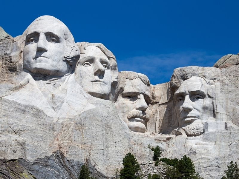 the faces of four presidents of the USA carved into a large mountain