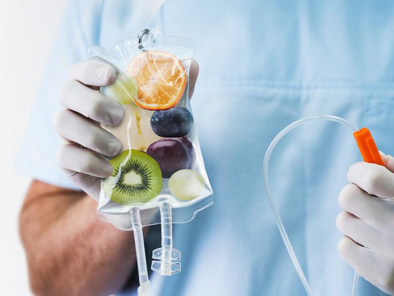 Administering Vitamin IV Drip Treatment
