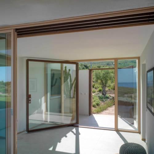 Vertical pivoting doors