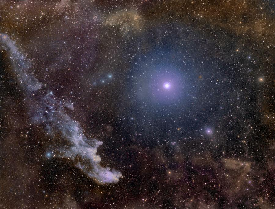A estrela gigante azul Rigel e a Nebulosa da Cabeça da Bruxa fotografadas por Rogélio Bernal Andreo