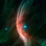 Spitzer revela Zeta Ophiuchi: uma estrela fugitiva e seu arco frontal de choque