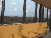 Laugh if you want, but I think this is the world's most beautiful bathroom. It is at the upper overlook at Þingvellir, is entirely glassed in, and has a stunning prospect, even when it is foggy. At the very least, it's the most attractive bathroom in Iceland.