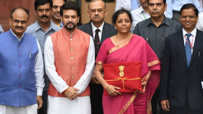Indian Finance Minister Nirmala Sitharaman (2R) with Minister of State for Finance Anurag Thakur (2L) presents Union Budget 2019 on July 5, 2019.