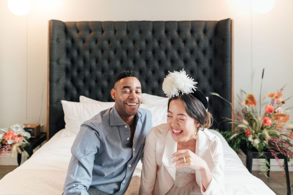 couple in ethical fashion on bed at Hotel G, dreaming of their ethical wedding