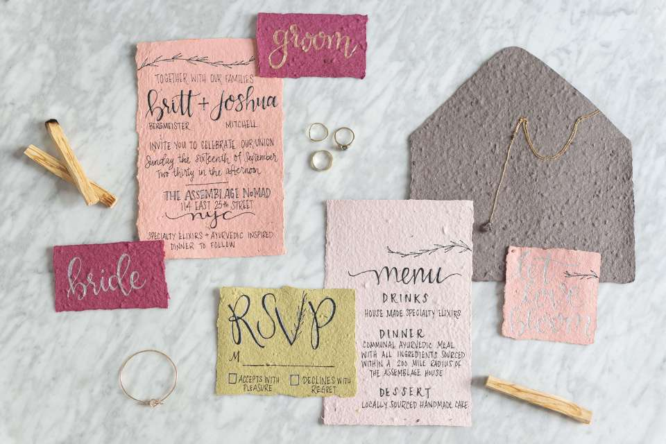 A beautiful flatly of eco friendly wedding invitations in a simple yet elegant palette of pinks and greens.