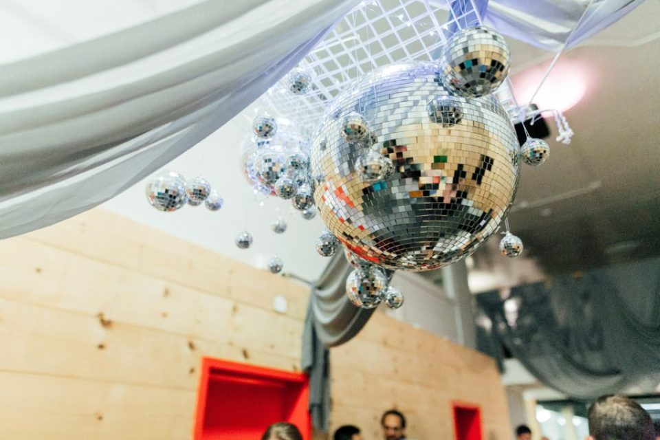Hanging disco balls from ceiling of the venue