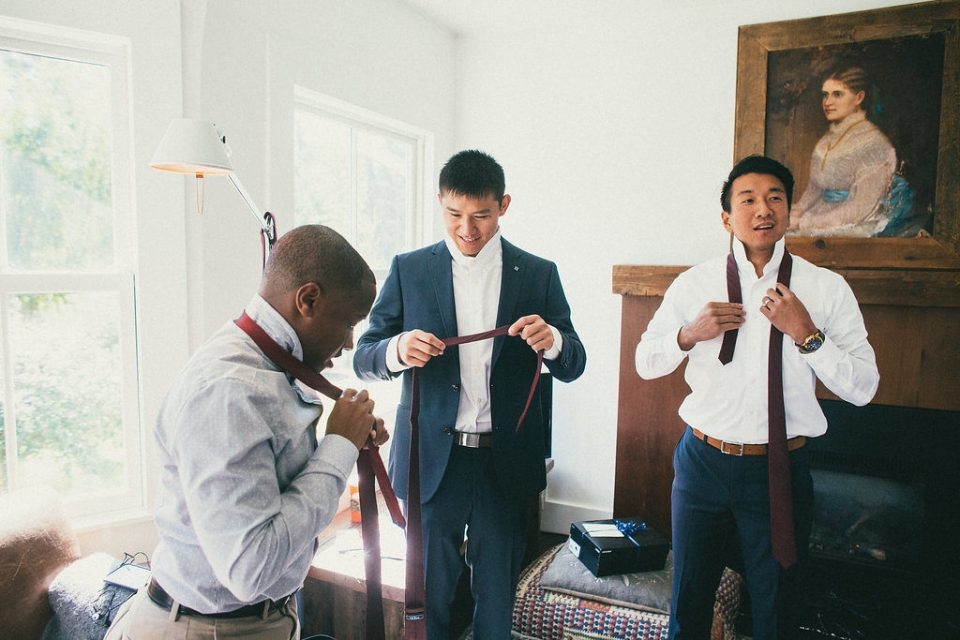 groomsmen getting dressed before the wedding