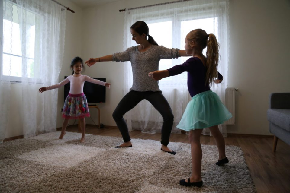 Emily teaching two young girls dance moves