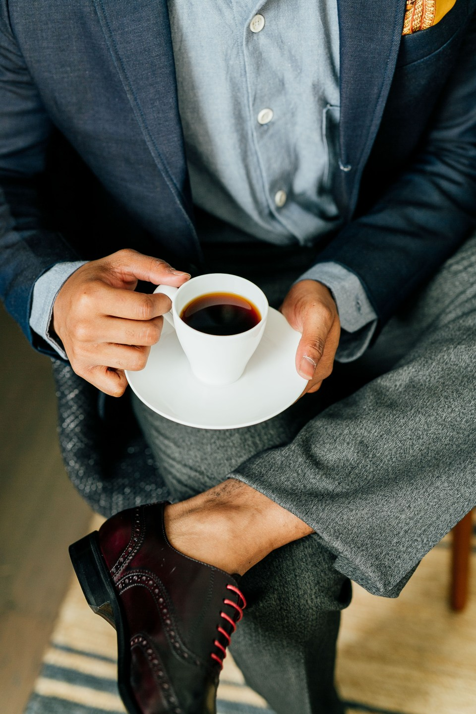 Ethically styled man holding cup of coffee