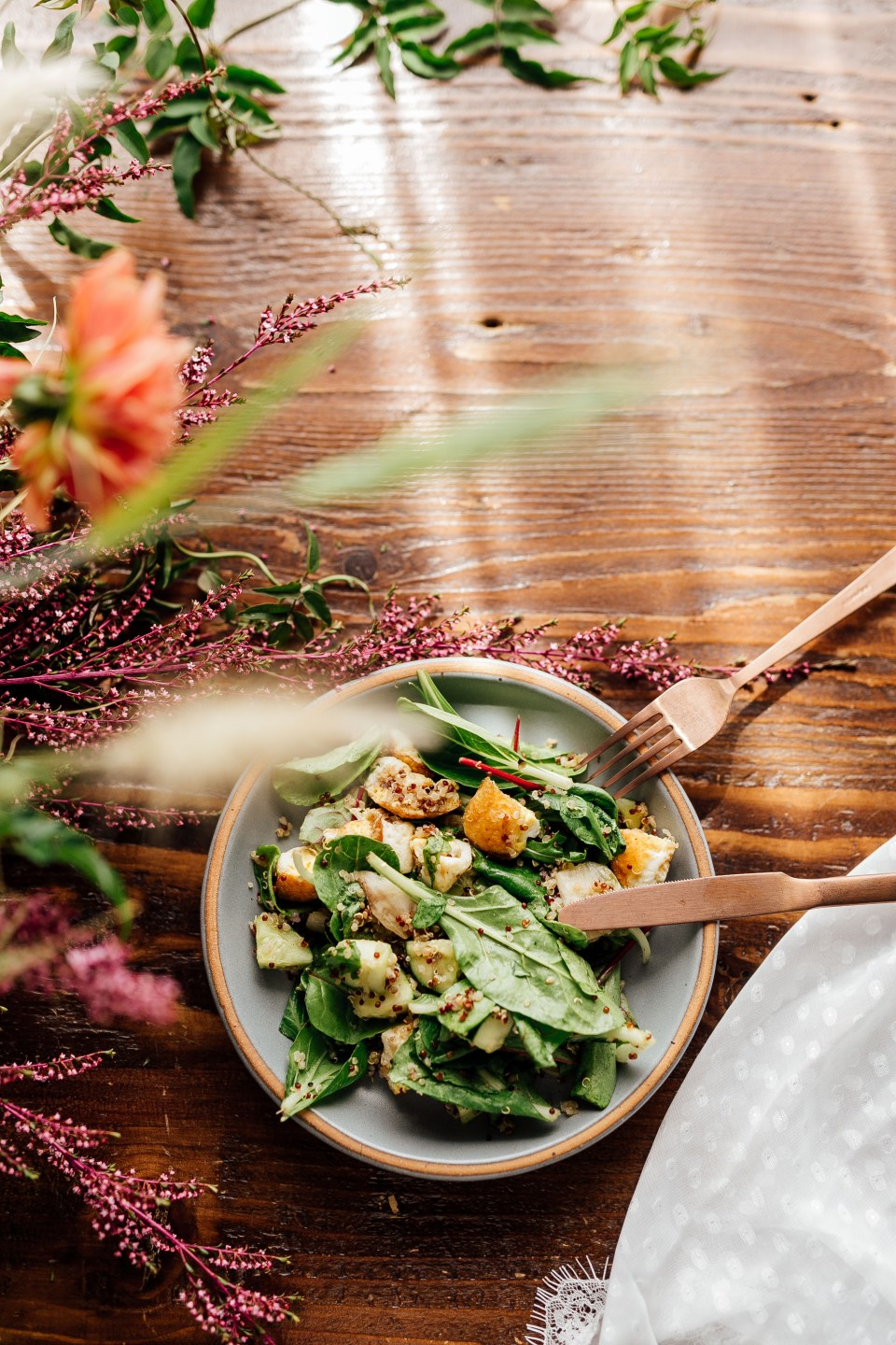 Overhead shot of salad on plate on wooden table