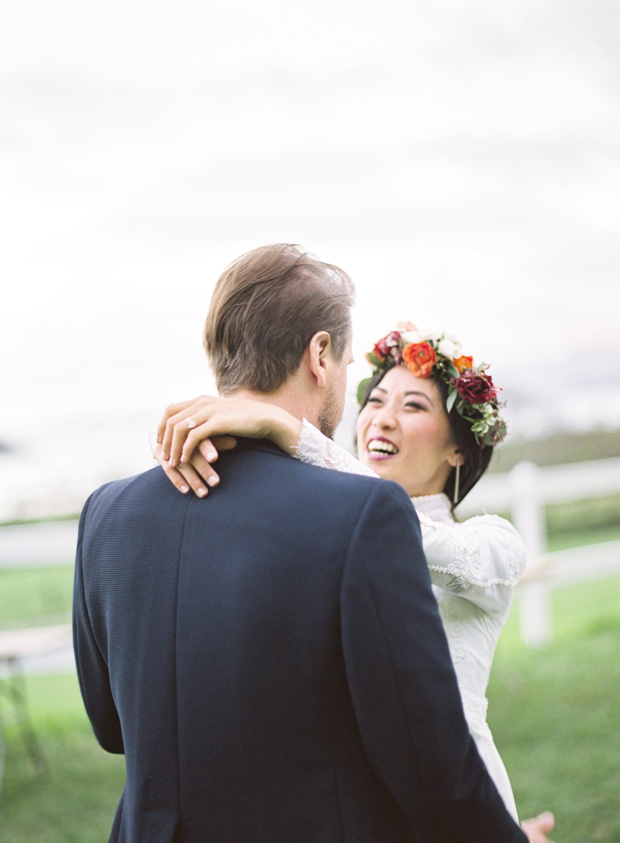 Bride smiles, embracing groom