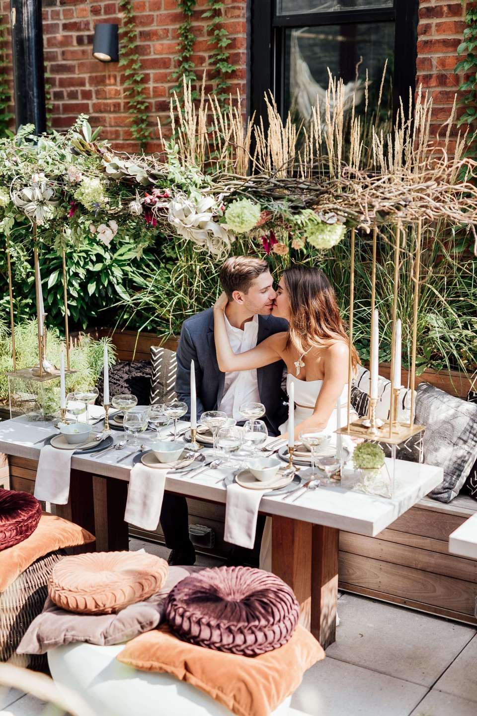 A photo of a beautiful, earthy and ethical wedding decor, featuring warm hues, intimate dining, rustic florals and eco friendly rentals from a sustainable wedding rental company.