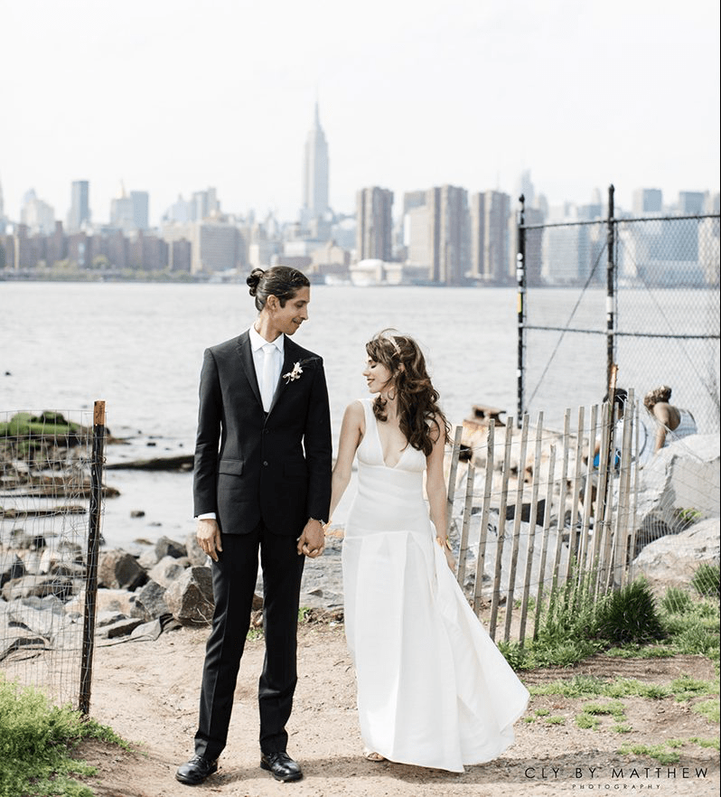 Alden and her husband pose outside in Brooklyn Nyc. Alden Wicker shares her tips for how to plan an eco-friendly wedding.
