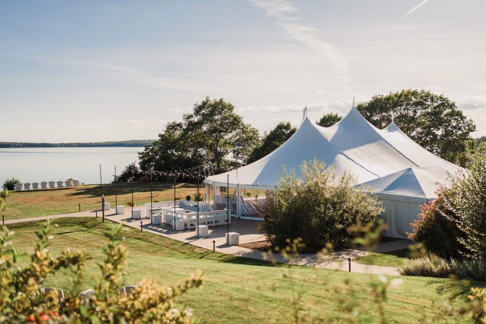 The beautiful tent and reception overlooking this intimate waterfront wedding in Maine.