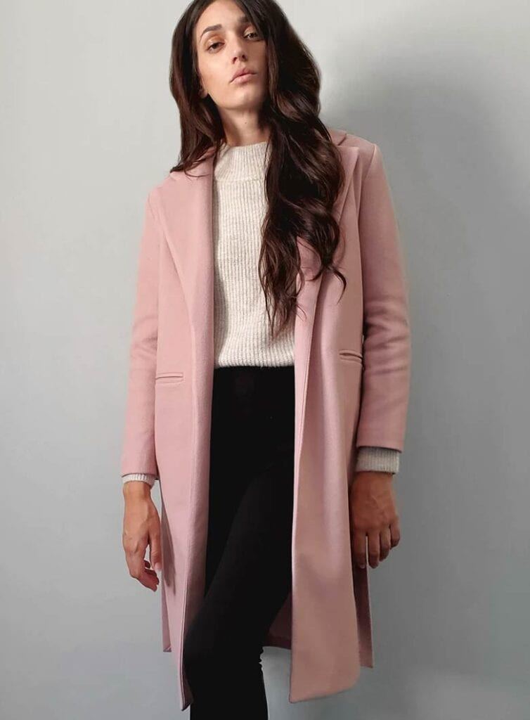 A smart and slim fitted, mid-length vegan coat