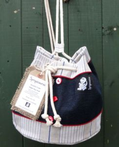 Sprigasaurus navy and striped duffel bag