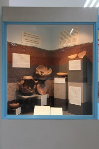Figure 8. Exhibit case featuring stratigraphy, ceramic seriation, and changes in burial practices over time