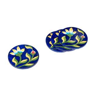 handmade blue pottery coasters sold by Ethiqana a shop specialising in eco friendly products, earth friendly products and sustainable products.