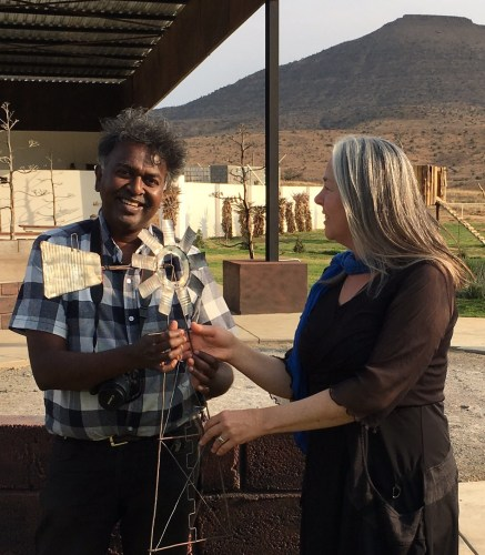 Lien Botha presents Darryl David with the Order of the Wind Pump as recognition for his initiatives and hard work as organiser of many festivals around the country.