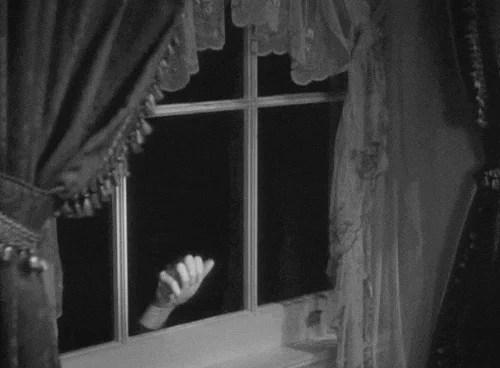 A mão na janela