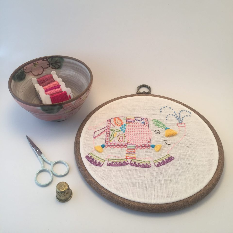 Pink elephant hand embroidered picture in a hoop