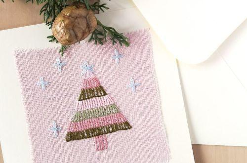 Hand made embroidered Christmas greetings card with Christmas tree