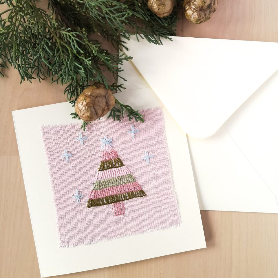 Greeting card with hand embroidered Christmas tree on pink linen