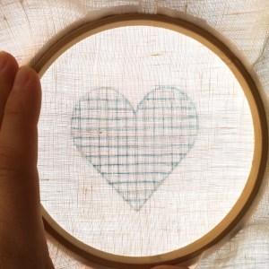 Transferring a heart shape on a sunny window
