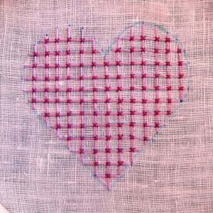 Hand embroidered heart shape with pink threads